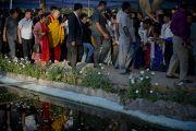 Его Святейшество Далай-лама покидает место проведения учений в парке «Будда Джаянти», организованных Тибетским домом и центром медитации «Тушита». Нью-Дели, Индия. 9 марта 2013 г. Фото: Тензин Чойджор (офис ЕСДЛ).